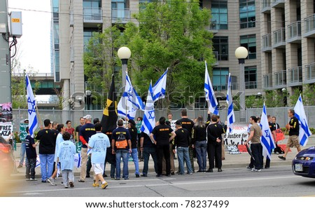 "TORONTO – MAY 29: Participants of annual  marsh ""Walk with Israel"" in May 29, 2011 in Toronto discussing with supporters of Gaza."