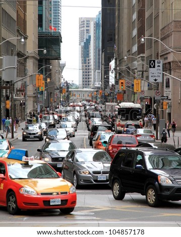 TORONTO-MAY 27 - Traffic conditions in Downtown on May 27, 2012 in Toronto. Toronto is the 4th most congested city in North America and the average Torontonian spends seven hours a week in traffic. - stock photo