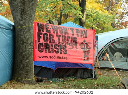 TORONTO - NOVEMBER 7: A banner by the Canadian Socialists at the Occupy Toronto Movement sit-in on November 7, 2011 in Toronto, Canada.