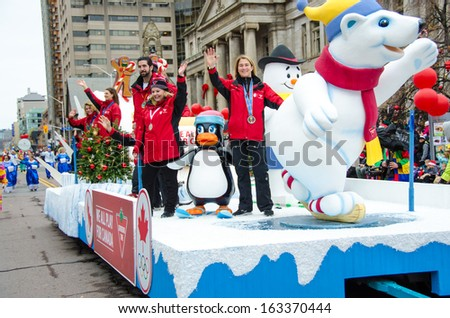 TORONTO, NOVEMBER 17: Celebration of the 109th edition of the Santa Claus Parade. More than a half million people attend the parade every year. As seen on November 17, 2013 in Toronto, Canada - stock photo