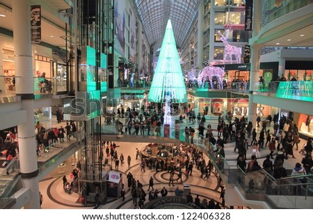 TORONTO - NOVEMBER 23: Christmas shopping at the Eaton Centre on November 23, 2012 in Toronto. The mall contains a wide selection of 230 stores and restaurants. - stock photo