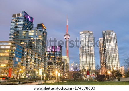 TORONTO - NOVEMBER 25, 2013: downtown skyline during the blue hour. The CN tower, completed in 1976, is one of the highest free-standing structures in the world,with his 553 meter height - stock photo