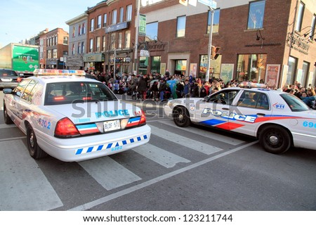 TORONTO - NOVEMBER 18: Toronto Police cars on November 18, 2012 in Toronto. The Toronto Police Service has approximately 5,400 uniformed officers and 2,500 civilian employees. - stock photo