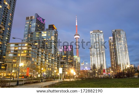 TORONTO - NOVEMBER 25, 2013: view of Toronto downtown and CN tower.The CN tower is  one of the highest structures in the world and a tourist landmark. - stock photo
