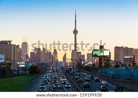 TORONTO-OCTOBER 9: CN Tower at dawn as seen from the QEW. One of the highest structures in the world and a tourist landmark as shown on October 9, 2013 in Toronto, Canada. - stock photo