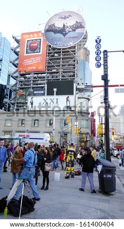 TORONTO - OCTOBER 20: Dundas square on October 20, 2013 in Toronto. The square was conceived in 1998 to revitalize Yonge & Dundas intersection and was designed by Brown and Storey Architects. - stock photo