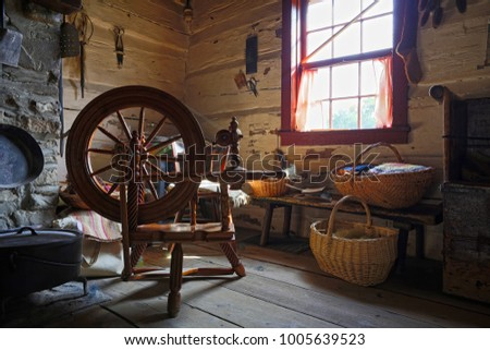 TORONTO OCTOBER 7: Interior of an old country house with antique spinning wheel in Black Pioneer Village, a living history museum in Toronto, Ontario, Canada in October 7, 2014.