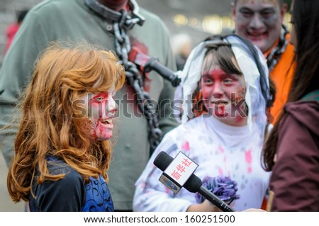 TORONTO - OCTOBER 26: People take part in the 11th Zombie Walk Parade in Toronto, Canada on October 26, 2013.