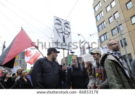 TORONTO - OCTOBER 17: Protestors marching in a rally during the Occupy Toronto Movement on October 17, 2011 in Toronto, Canada. - stock photo
