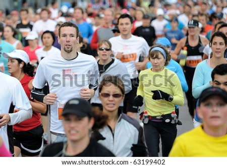TORONTO-OCTOBER 17: The GoodLife Fitness Toronto Marathon is the oldest Marathon in Toronto, generating over $25 million to the local economy on October 17, 2010 in Toronto. - stock photo