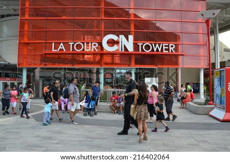 TORONTO,ON -AUGUST 31 : Skywalk at CN Tower, on August 31, 2014 in Downtown Toronto, Canada. CN Tower is a famous attraction with more than 2 million visitors annually, and 1,815 ft. tall - stock photo