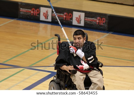 TORONTO, ONTARIO - AUGUST 7: An unidentified disabled young athlete in the wheelchair plays in the Power Hockey Cup on August 7, 2010 at Ryerson Universiy in Toronto, Ontario, Canada