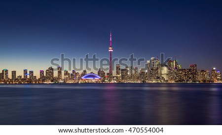 Toronto, Ontario, Canada | August 1st 2016 The Skyline of the Canada's largest city at dusk. Taken from Centre Island.