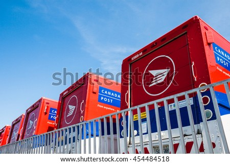 TORONTO, ONTARIO/CANADA - MAY 16, 2010: Canada Post mail vehicles parked outside a sorting facility.