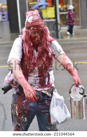 TORONTO, ONTARIO/CANADA - 26th SATURDAY  OCTOBER 2013 : Man dress up as zombie on 11th annual Zombie in Toronto,Canada.  - stock photo