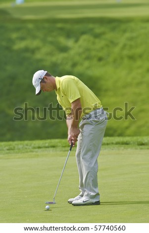 TORONTO, ONTARIO - JULY 21:English golfer Paul Casey putts during a pro-am event at the RBC Canadian Open golf on July 21, 2010 on Toronto, Ontario. - stock photo