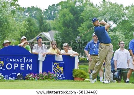 TORONTO, ONTARIO - JULY 21 : South African golfer Retief Goosen follows his tee shot during a pro-am event at the RBC Canadian Open golf on July 21, 2010 in Toronto, Ontario - stock photo