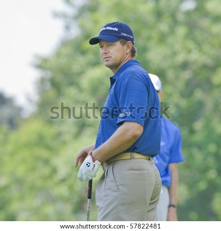 TORONTO, ONTARIO - JULY 21: South African golfer Retief Goosen follows his tee shot during a pro-am event at the RBC Canadian Open golf on July 21, 2010. - stock photo