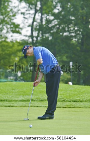 TORONTO, ONTARIO - JULY 21: South African golfer Tim Clark putts during a pro-am event at the RBC Canadian Open golf on July 21, 2010 in Toronto, Ontario - stock photo