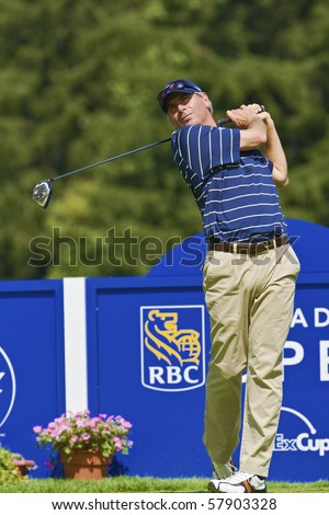 TORONTO, ONTARIO - JULY 21, 2010 : U.S. golfer Fred Couples follows his tee shot during a pro-am event at the RBC Canadian Open,St. George's; Golf and Country Club, Toronto, Ontario, July 21, 2010 - stock photo