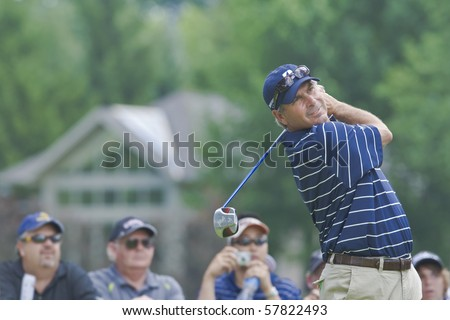 TORONTO, ONTARIO - JULY 21: U.S. golfer Fred Couples follows his tee shot during a pro-am event at the RBC Canadian Open golf on July 21, 2010. - stock photo