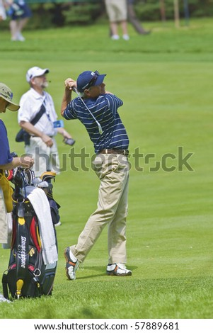 TORONTO, ONTARIO - JULY 21 : U.S. golfer Fred Couples follows his tee shot during a pro-am event at the RBC Canadian Open,   St. George's  Golf and Country Club,  July 21, 2010 in Toronto, Ontario. - stock photo