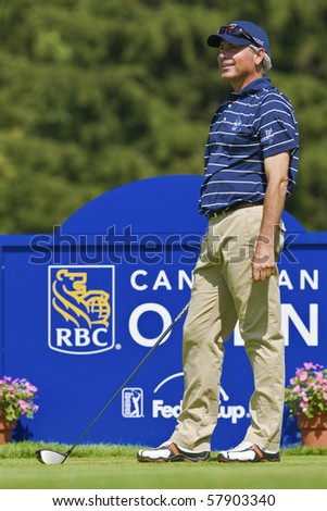 TORONTO, ONTARIO - JULY 21, 2010 : U.S. golfer Fred Couples prepares for  tee shot during a pro-am event at the RBC Canadian Open, St. George's; Golf and Country Club, Toronto, Ontario, July 21, 2010 - stock photo