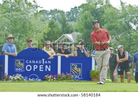 TORONTO, ONTARIO - JULY 21: US golfer Chris DiMarco keeps his eye on a tee shot during a pro-am event at the RBC Canadian Open, St. George's; Golf and Country Club on July 21, 2010 in Toronto, Ontario. - stock photo