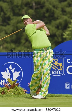 TORONTO, ONTARIO - JULY 21: US golfer John Daly lets a tee shot rip during a pro-am event at the RBC Canadian Open golf, St. George's, Golf and Country Club July 21, 2010 Toronto, Ontario. - stock photo