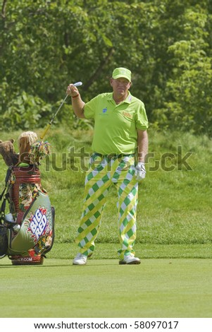 TORONTO, ONTARIO - JULY 21: US golfer John Daly picks his club during a pro-am event at the RBC Canadian Open golf, St. George's, Golf and Country Club July 21, 2010 Toronto, Ontario. - stock photo