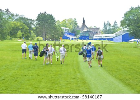TORONTO, ONTARIO - JULY 21: US golfer John Daly team walking to last hole during a pro-am event at the RBC Canadian Open golf, St. George's; Golf and Country Club; Toronto, Ontario, July 21, 2010 - stock photo