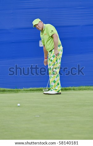 TORONTO, ONTARIO - JULY 21: US golfer John Daly watches his putt during a pro-am event at the RBC Canadian Open golf, St. George's; Golf and Country Club on July 21, 2010 in Toronto, Ontario. - stock photo