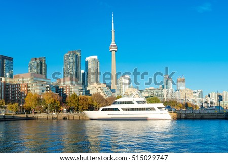 Toronto's skyline with CN Tower over lake. Urban architecture - Canada