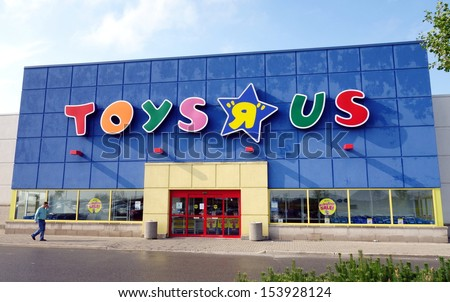 """TORONTO - SEPTEMBER 7: A Toys """"R"""" Us store on September 7, 2013 in Toronto. There are 875 Toys ? Us in the United States and more than 625 stores in other 35 countries. - stock photo"""