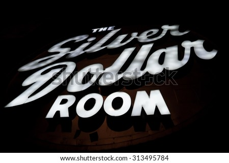 Toronto - September 4, 2015: The Silver Dollar Room sign, illuminated at night. A legendary music club in downtown Toronto, Canada opened in 1958. - stock photo
