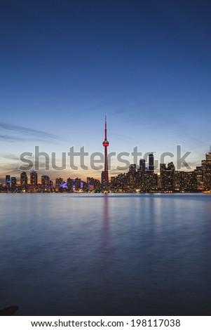 Toronto Skyline at Dusk Focusing on CN Tower - stock photo
