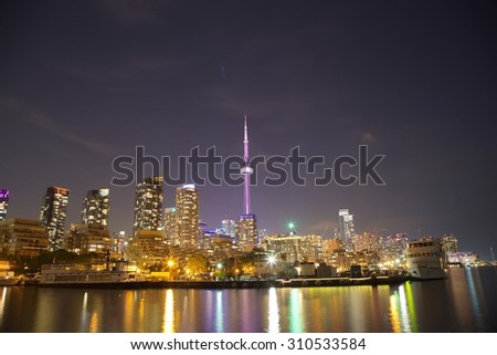 Toronto Skyline at night with a reflection in Lake Ontario