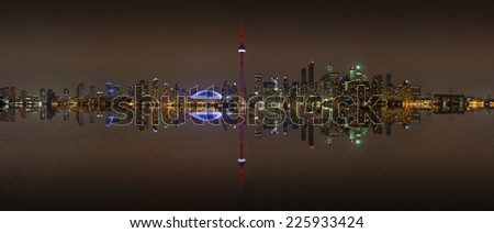 Toronto Skyline at night with a reflection in Lake Ontario, Canada - stock photo