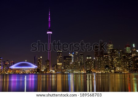 toronto skyline at night with reflection in lake