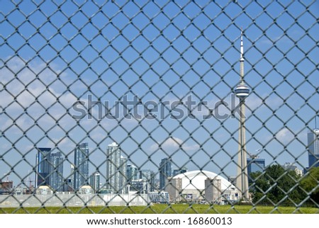 Toronto Skyline Behind Tall Link Fence
