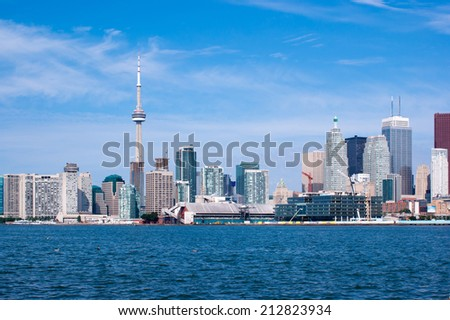 Toronto skyline under a clear sky. - stock photo