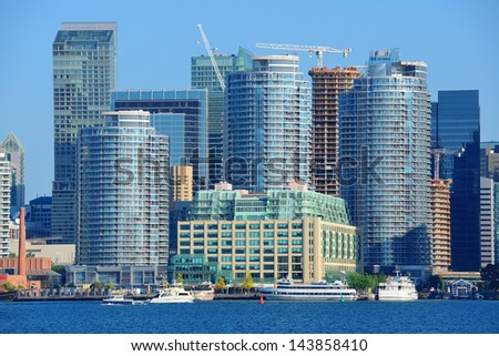 Toronto skyline with boat, urban architecture and blue sky - stock photo