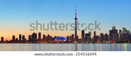 Toronto sunset over lake panorama with urban skyline.