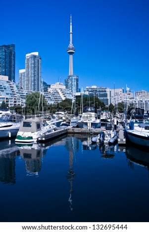 Toronto Yacht Club with beautiful blue lake and blue sky - stock photo