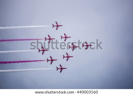 Torquay, Devon, UK, 12 June 2016 Showing the various formations of the RAF Red Arrows air display at the Torquay airshow, shot from public land during an overcast day - stock photo