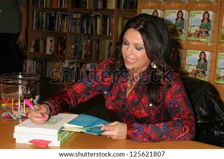 "TORRANCE, CA - DECEMBER 09: Rachael Ray at an in store appearance signing copies of her book ""Rachael Ray 2, 4, 6, 8: Great Meals for Couples or Crowds"", December 09, 2006 at Borders Books in Torrance"