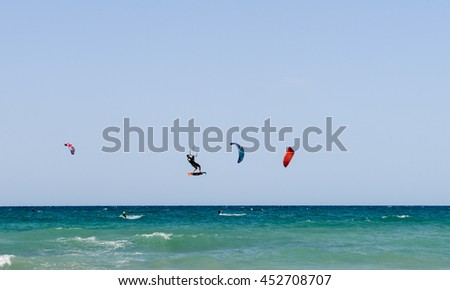 Torre Canne, Italy - 22 June 2016: People practicing kitesurf on the beach of Torre Canne on Puglia, Italy