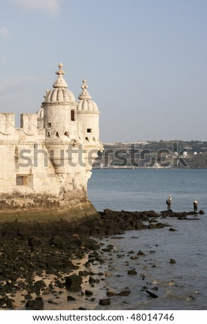 Torre de Belem Tower in Lisbon Portugal with Fisherman - stock photo