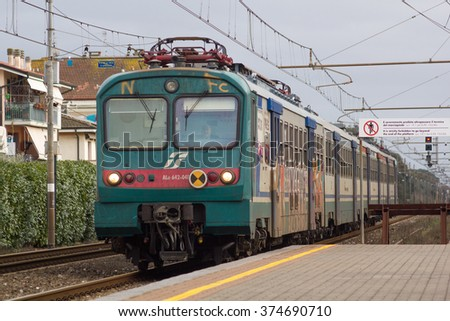 TORRE DEL LAGO PUCCINI-ITALY: FEBRAURY, 8 2016: Trenitalia Regional Passenger Train Model ALe 642 is Arriving in the Station.