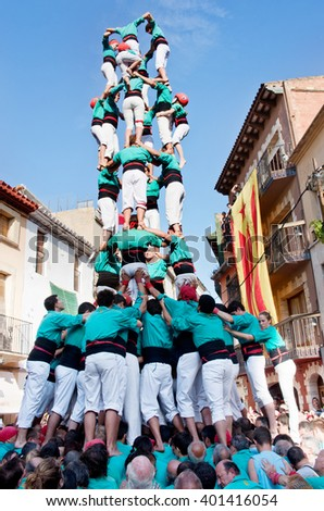 TORREDEMBARRA, SPAIN - JULY 13, 2014: Castells Performance   in Torredembarra, Catalonia, Spain. A Castell is a  Human Tower  built traditionally in Catalonia.  - stock photo